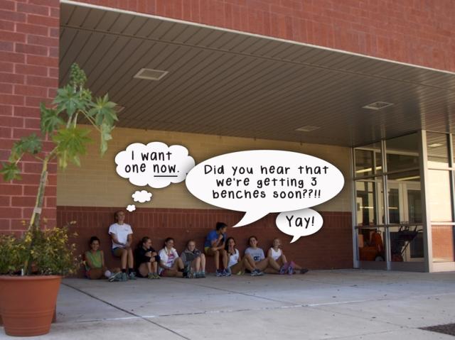 High school students sitting on pavement