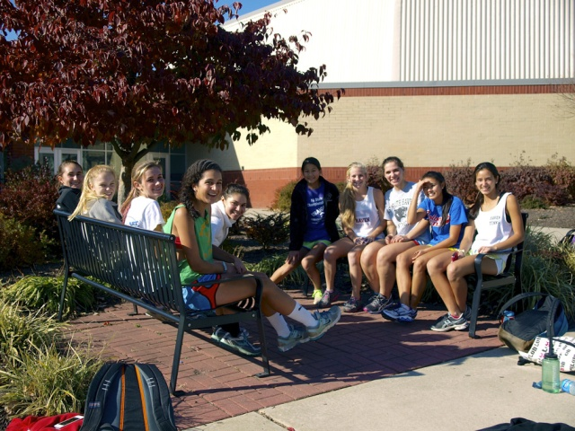 Photograph of shhs girls' indoor track team on benches